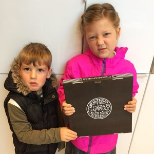 My two children standing with the pizza box they found the morning after our illicit takeaway! They don't look happy!