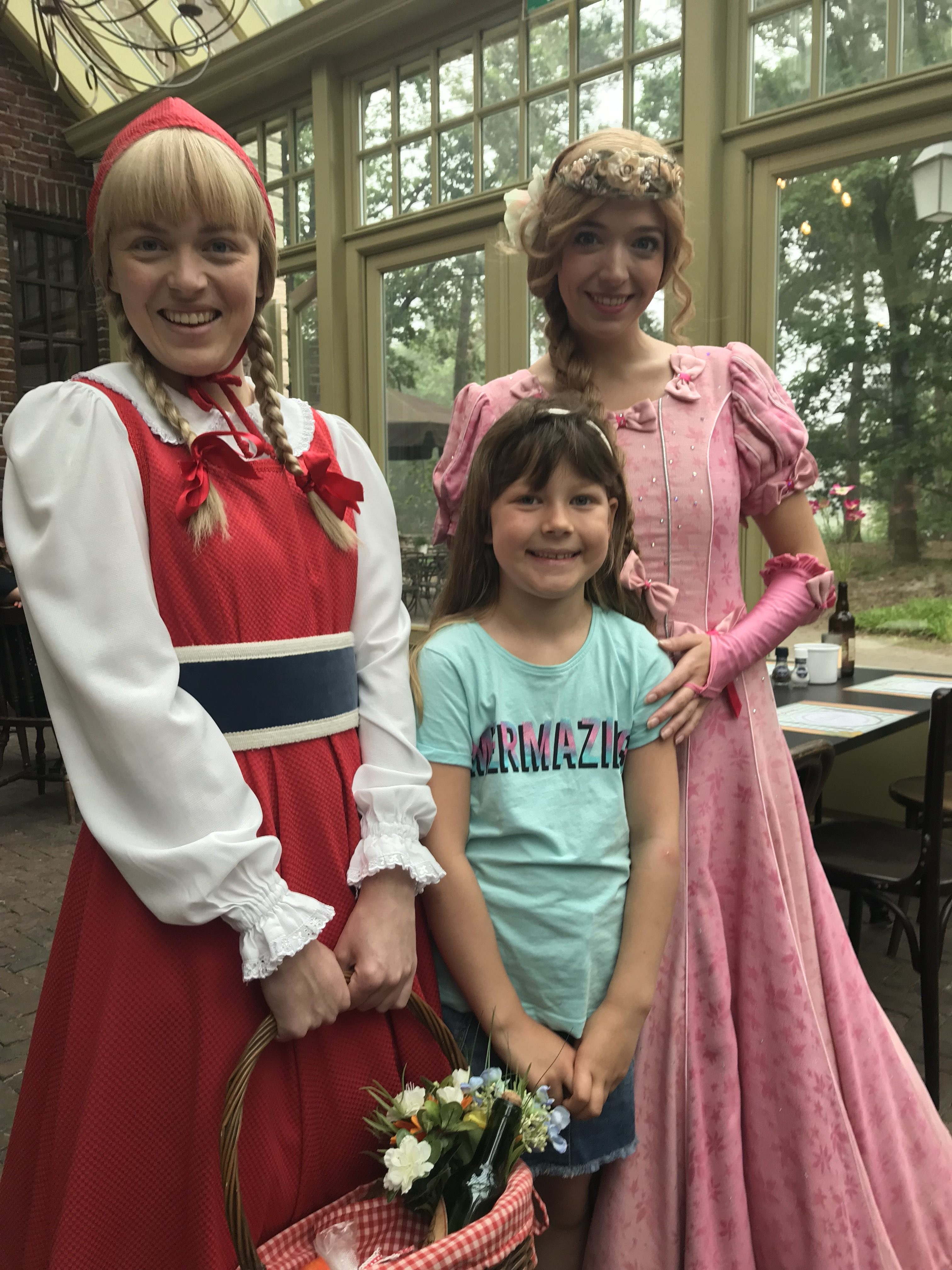 A photo from the Efteling theme park in South Holland, we were at breakfast and two characters from the park came over to talk to her. In the photo she is standing with Red Riding Hood and Sleeping Beauty, both in lovely costumes.