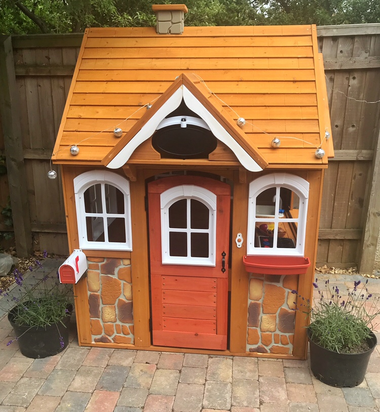The finished Stoney Creek Playhouse from KidKraft. Assembly tips included in the blog post.