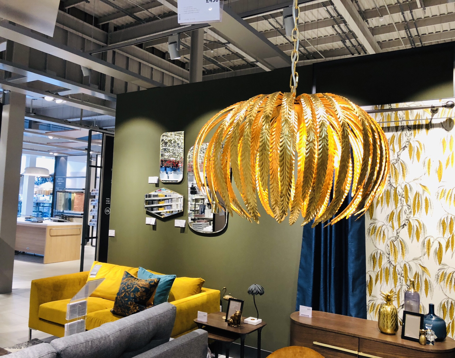 Some beautiful sofa and lounge area styling at John Lewis Cheltenham with mustard and turquoise accents and a stunning gold lampshade.