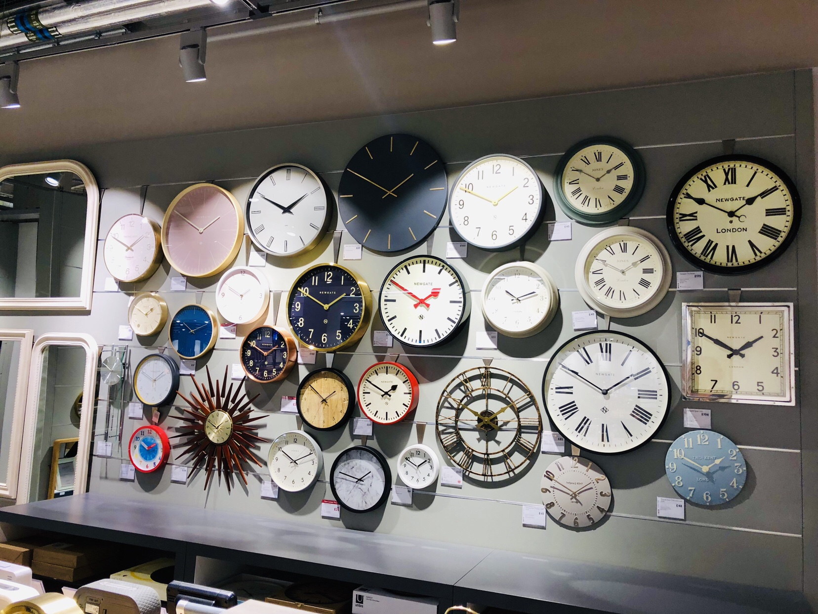 A wall of clocks at John Lewis Cheltenham