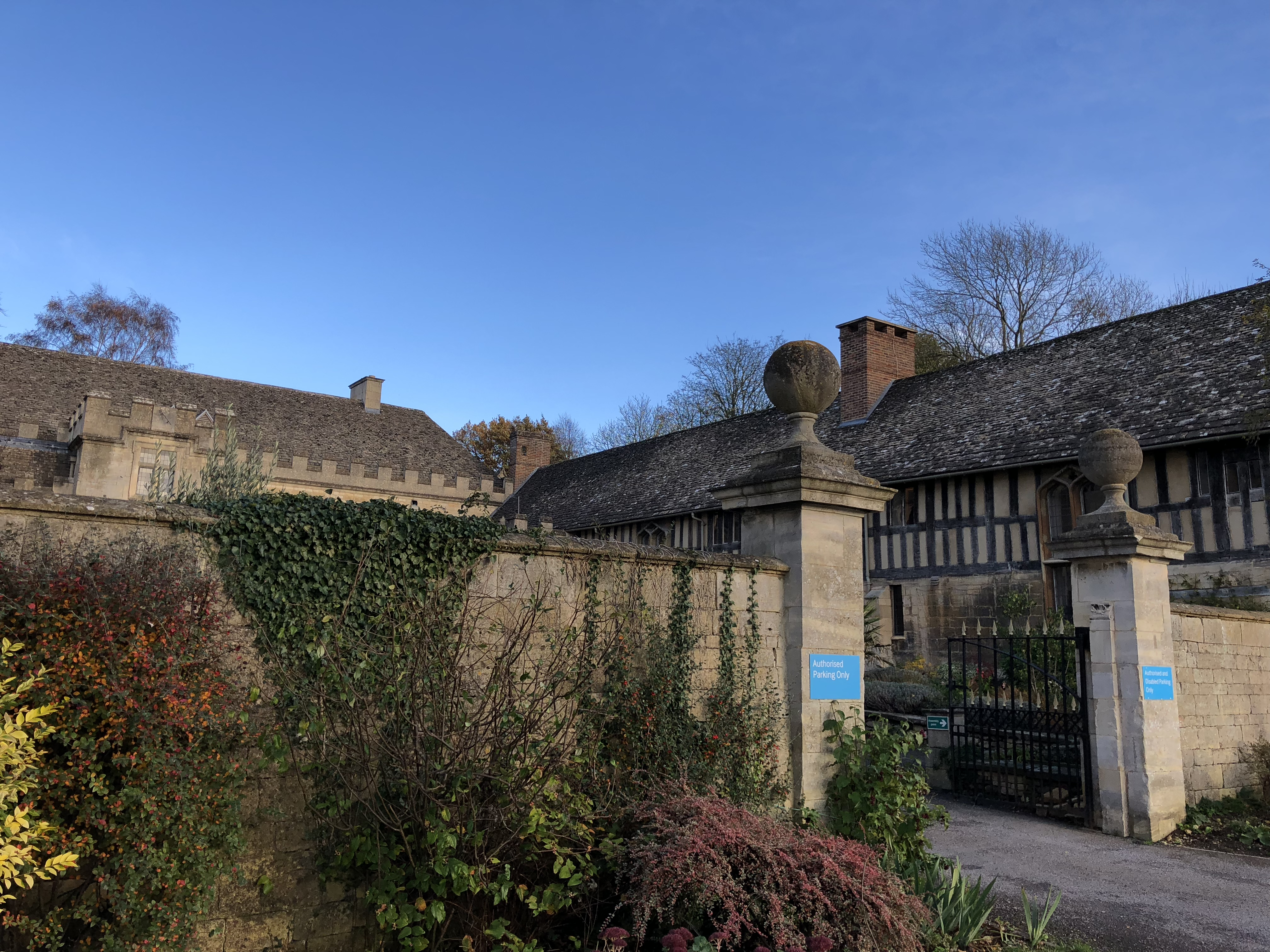 A view from the front of the Leckhampton Court Hospice with the gorgeous building and a very blue sky above.
