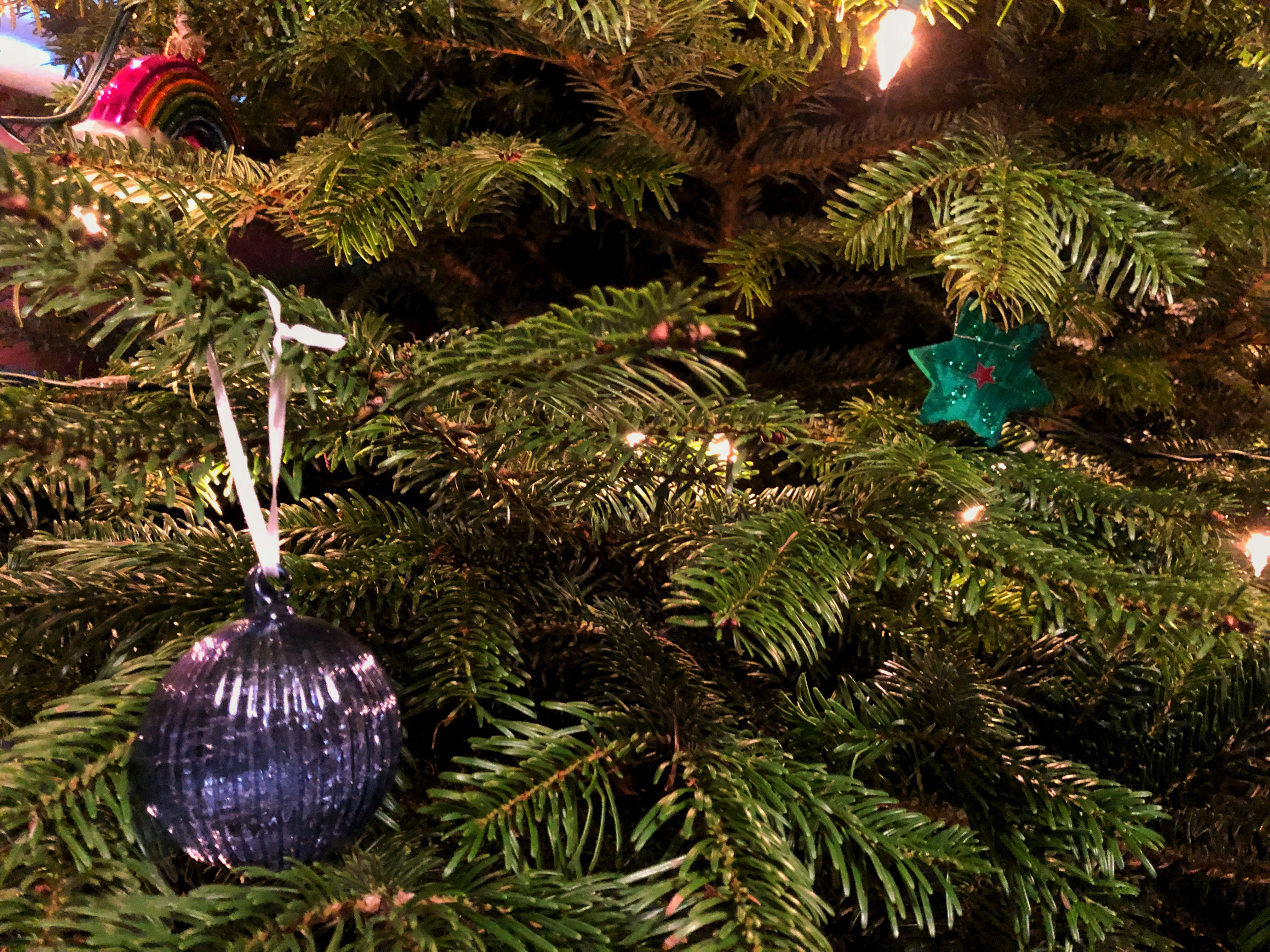 A close up of our Christmas Tree from Christmas forest with a few of our decorations on.