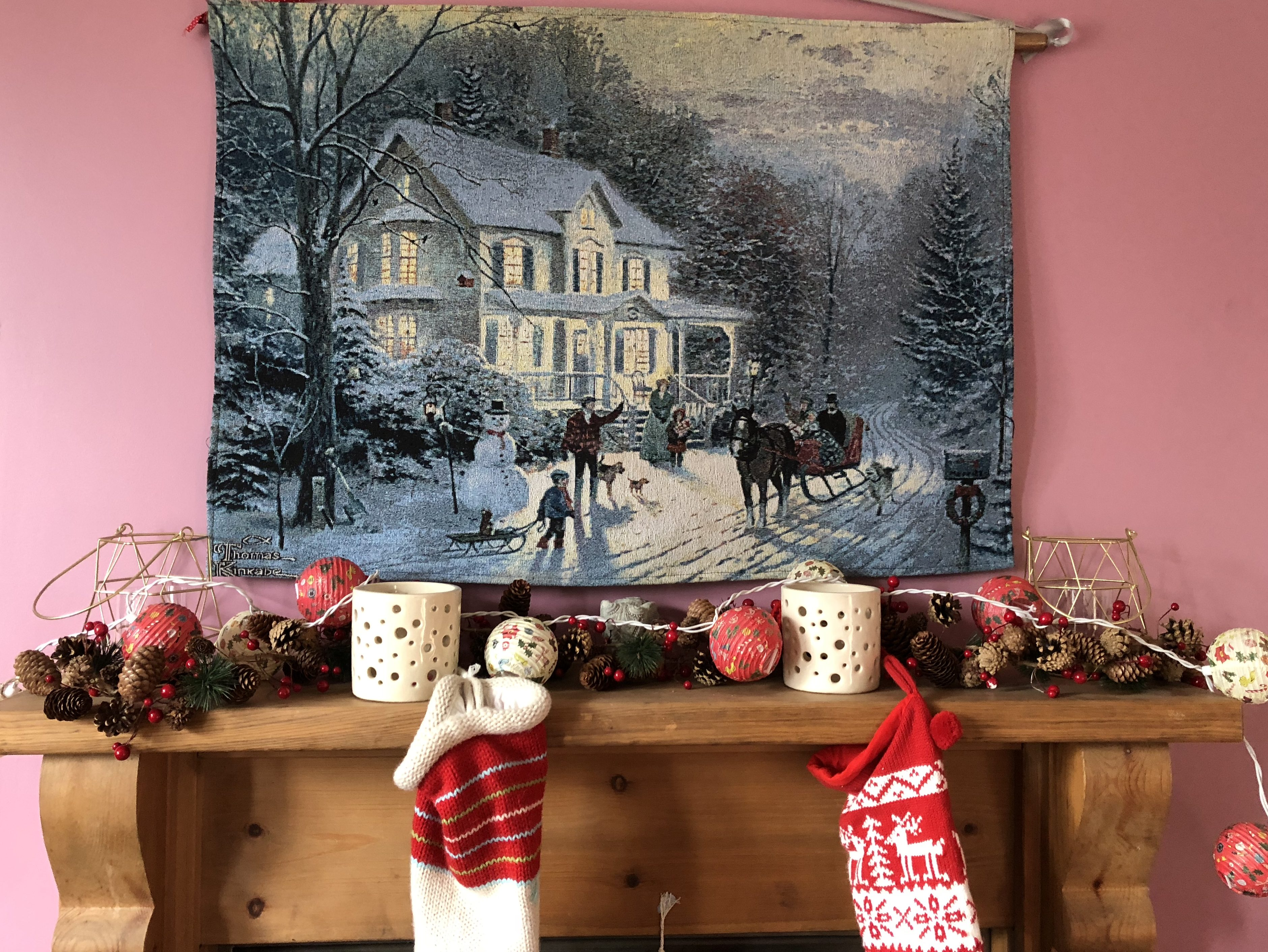 Is Christmas the best time to sell a house? My festive mantlepiece complete with stockings and snowy house scene tapestry.