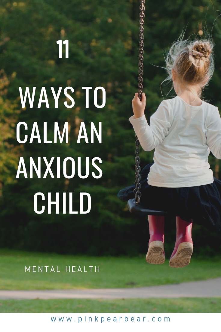 Pinnable image of a girl on a swing with text overlaid in white font that says '11 ways to calm an anxious child'.
