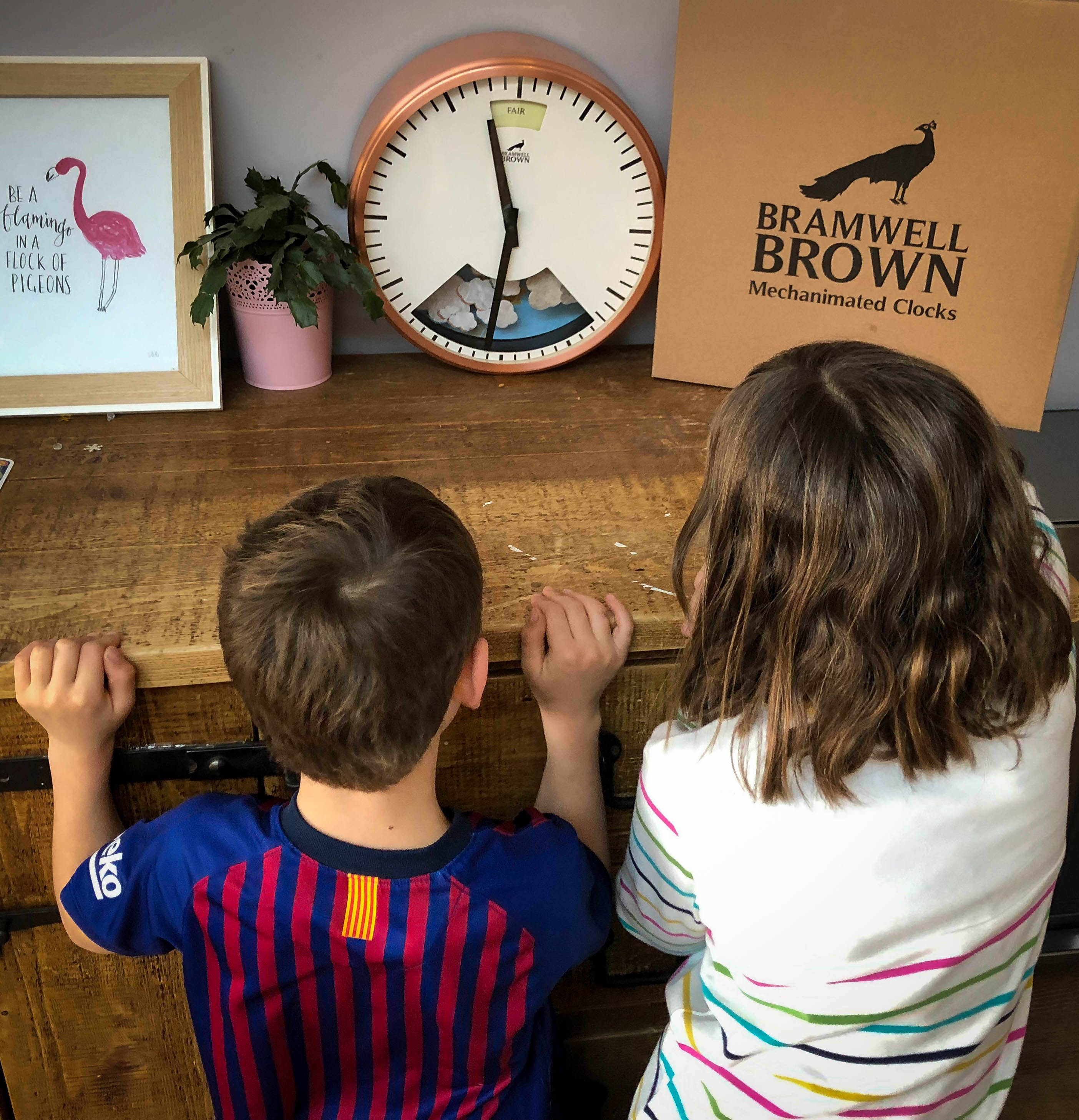 My two children looking at their Bramwell Brown clock waiting to see what the weather will be.