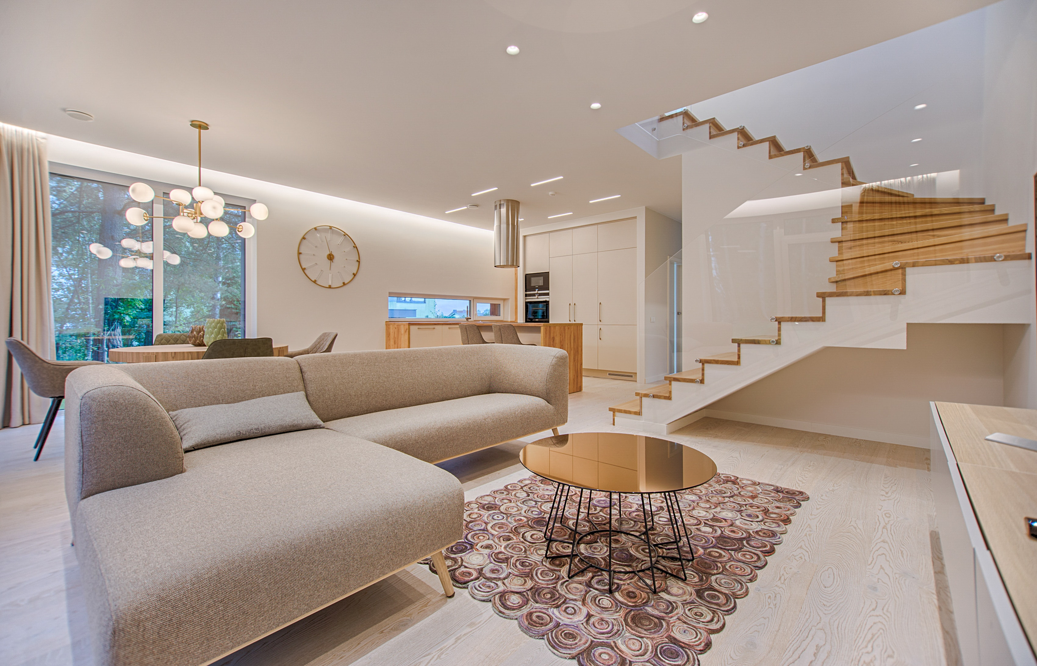 A stock image of a beautiful home that isn't mine! Lots of beige and white and fancy wooden stairs behind perspex!