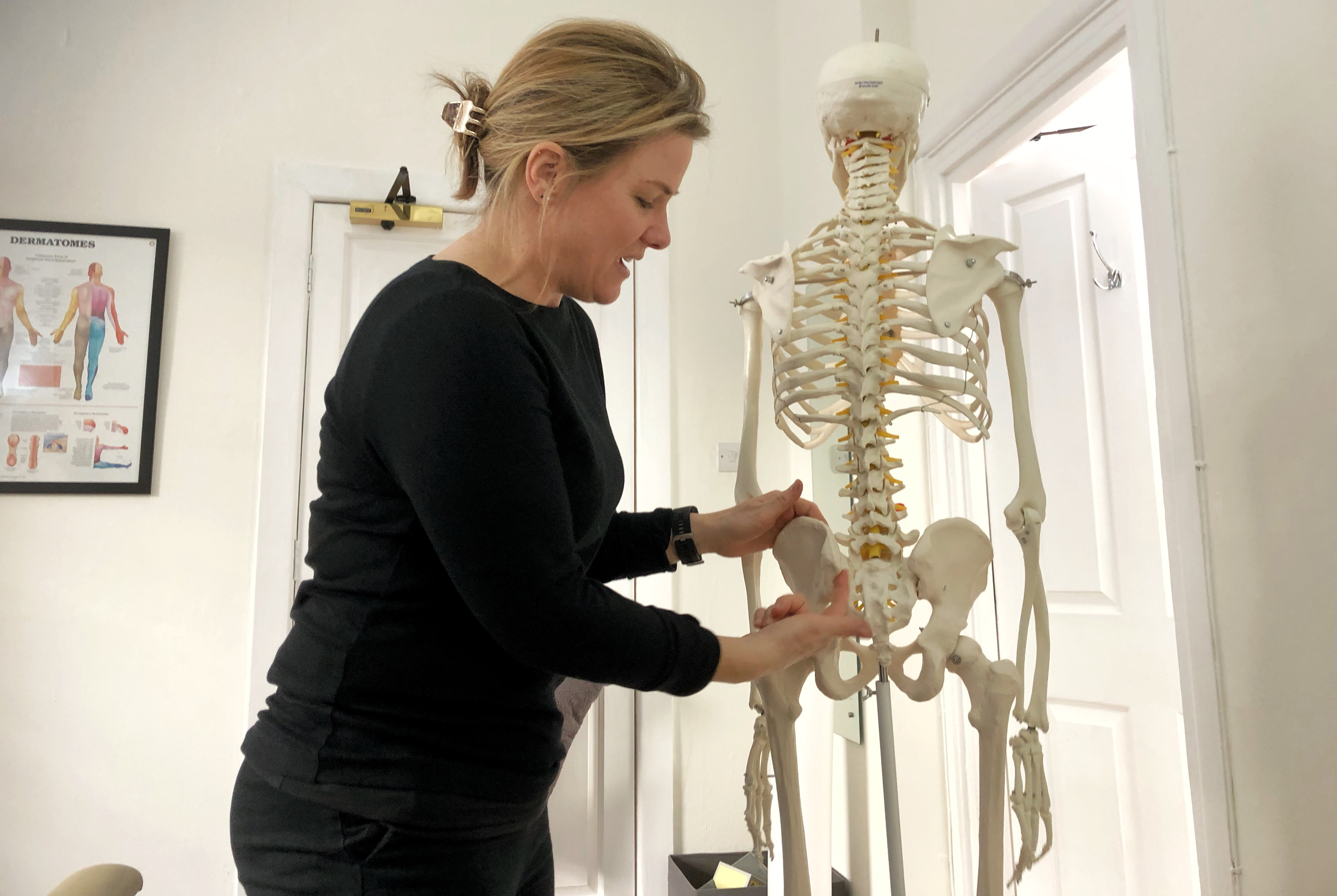 Hilary the chiropractor at Move Chiropractic in Cheltenham using a model skeleton to talk me through what is going on with my body.