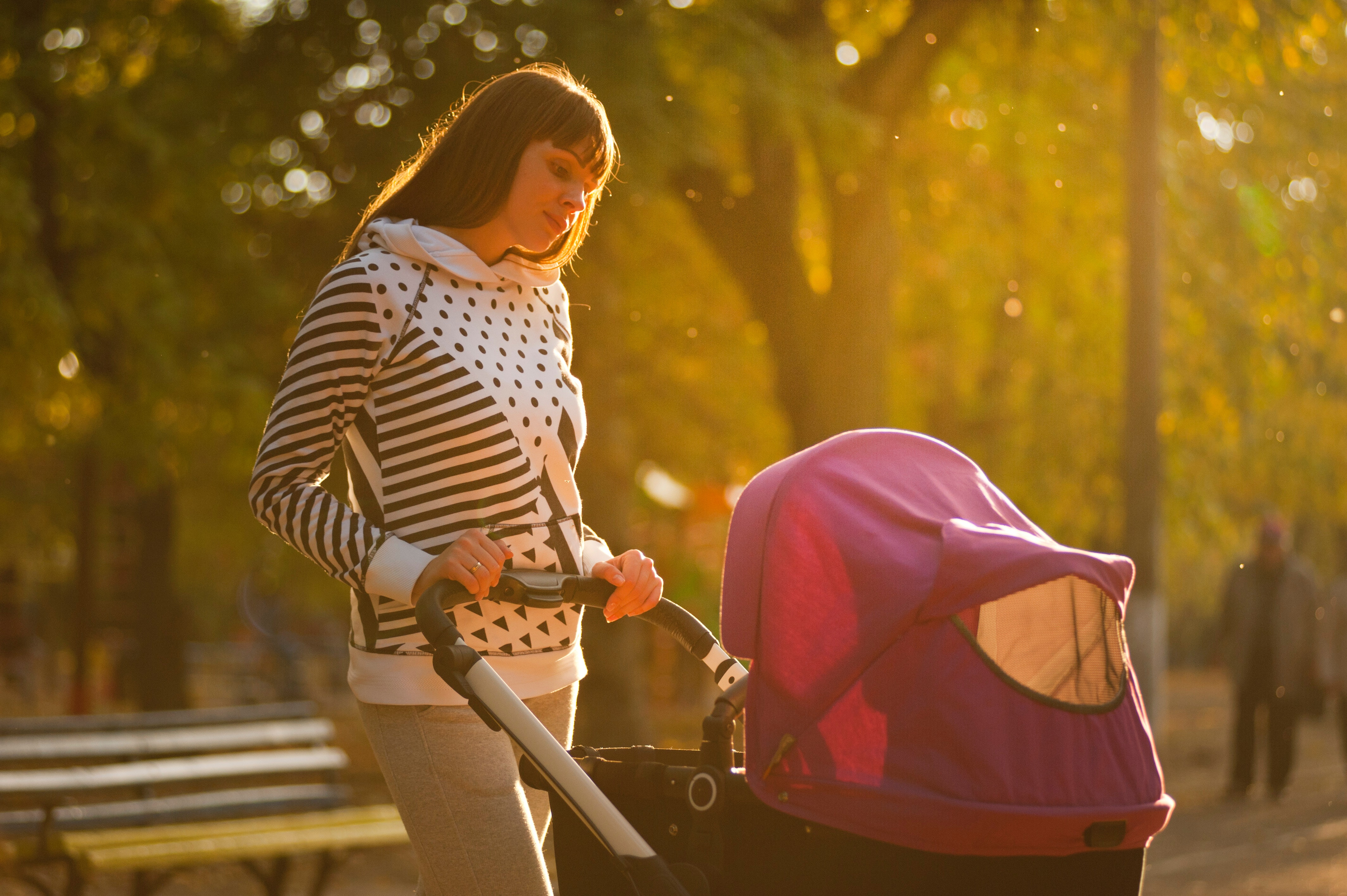 A stock photo of a woman with a buggy looking onsite for a post about postnatal depression, motherhood and mayhem.