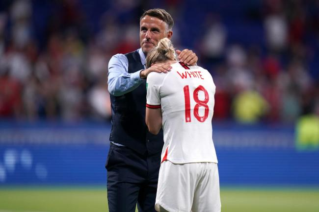 Stock image of Phil Neville comforting Ellen White at the end of the Lionesses World Cup game against the USA.