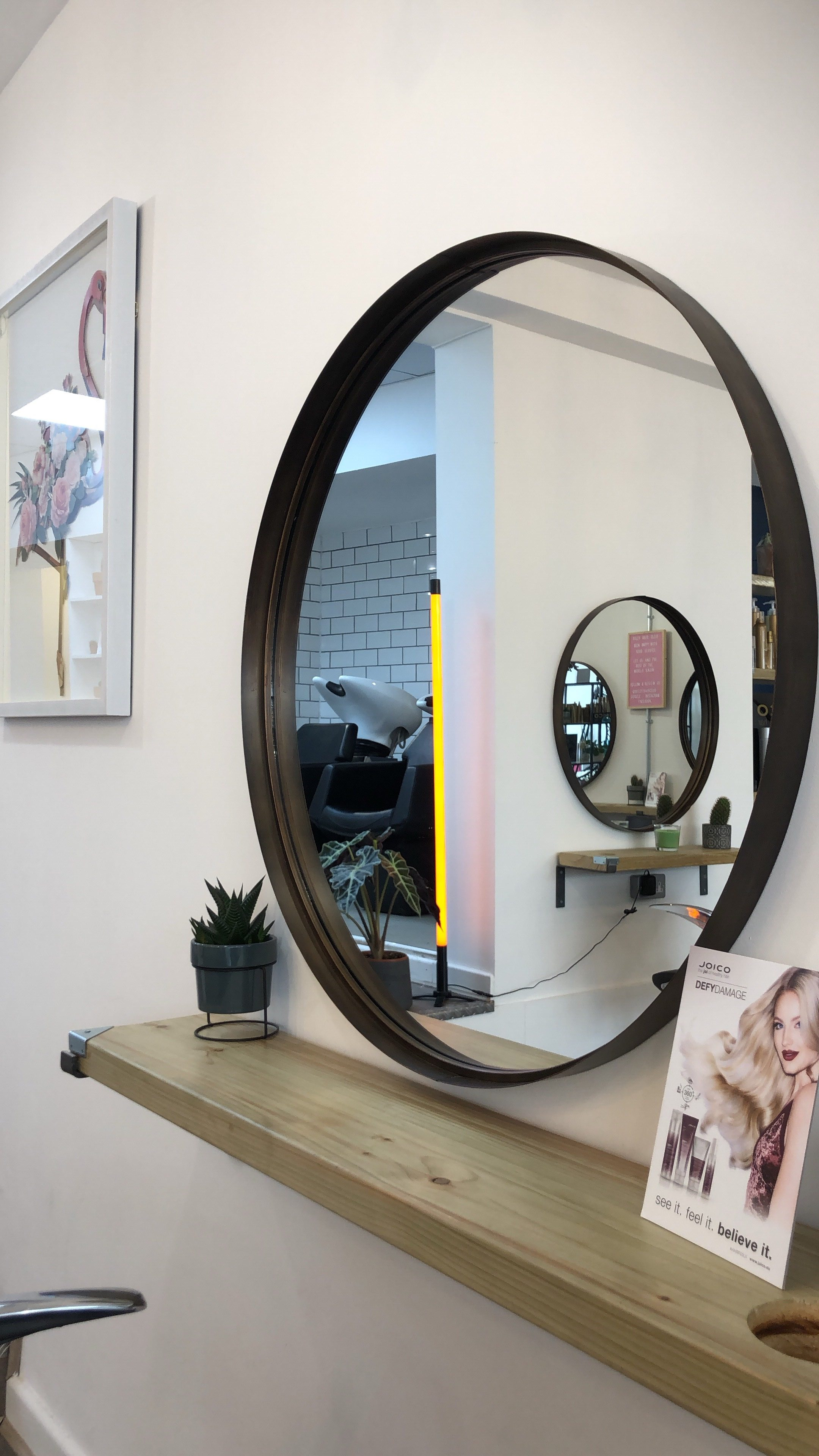 A photo of the beautiful oval mirror in the Hiley Hair Club in Cheltenham.