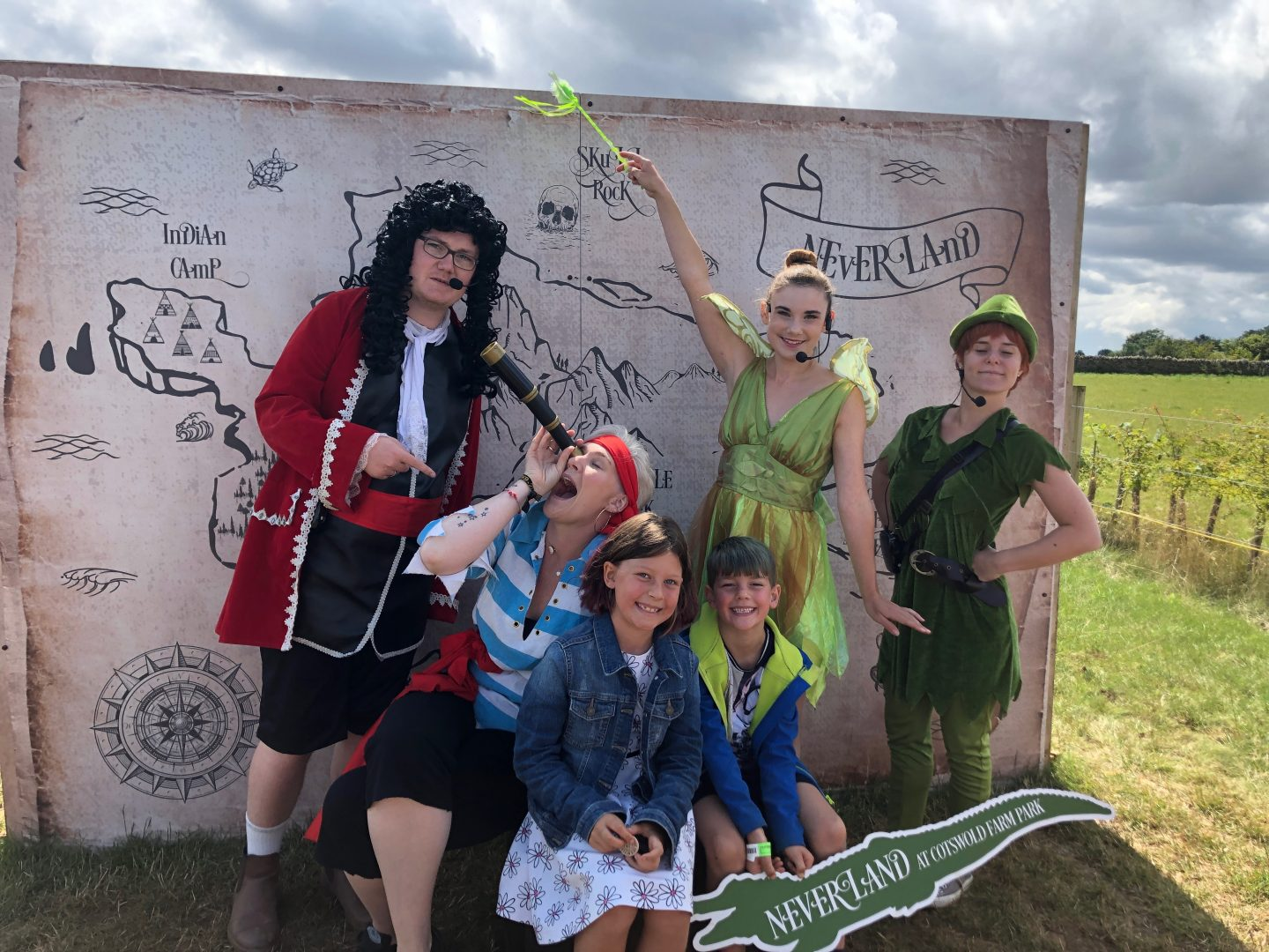A photo of my son and daughter with the cast of the maize maze pantomime style show at the Cotswold Farm Park over the summer.