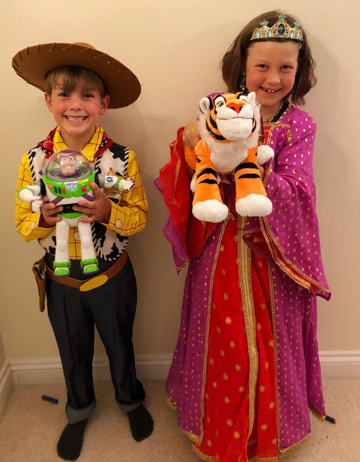 A photo of my son and daughter dressed up in their shopDisney costumes, or rather, it's Woody and Princess Jasmine!