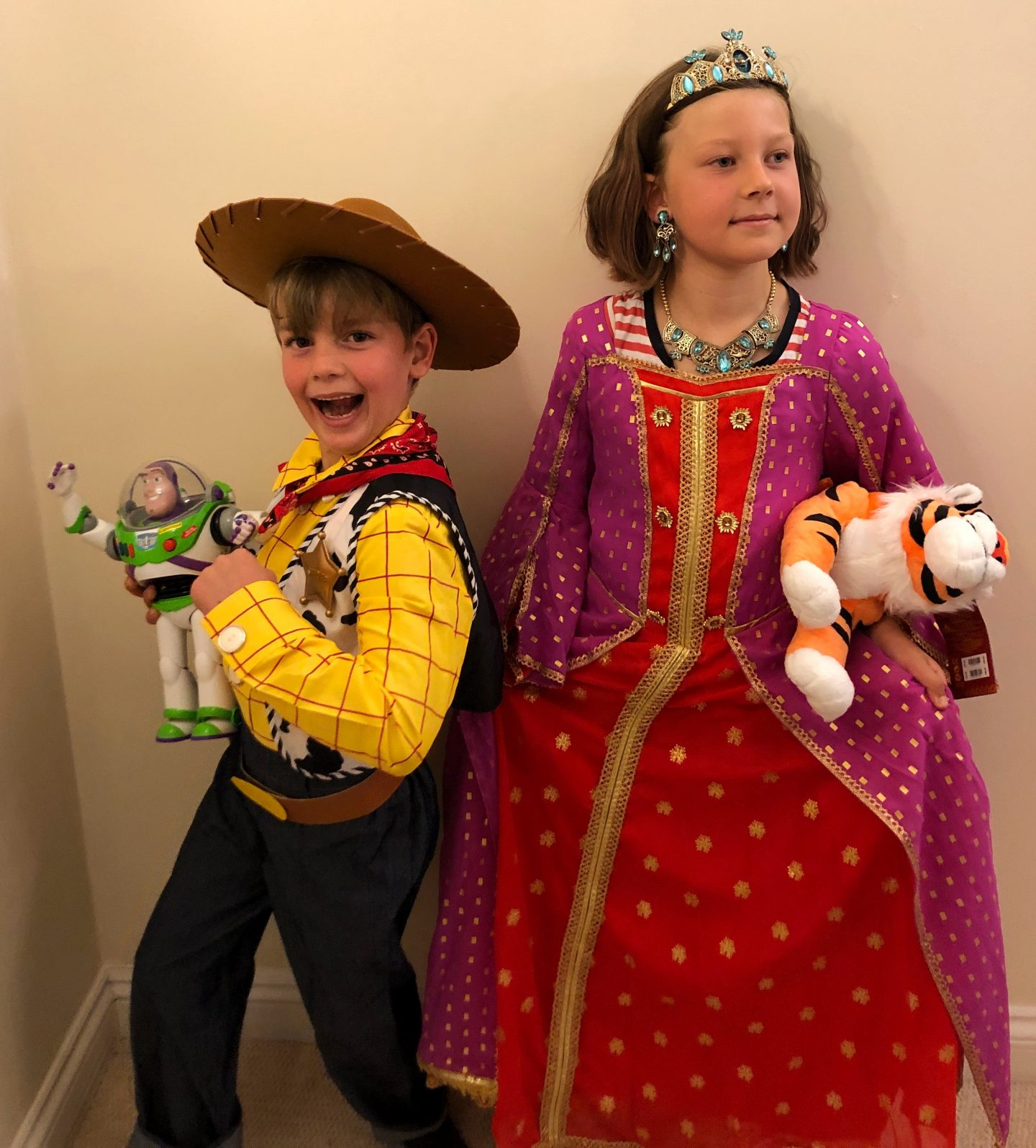My two children getting into character in their shopDisney costumes. My son as Woody from Toy Story and my daughter going for a regal expression as Princess Jasmine from Aladdin.