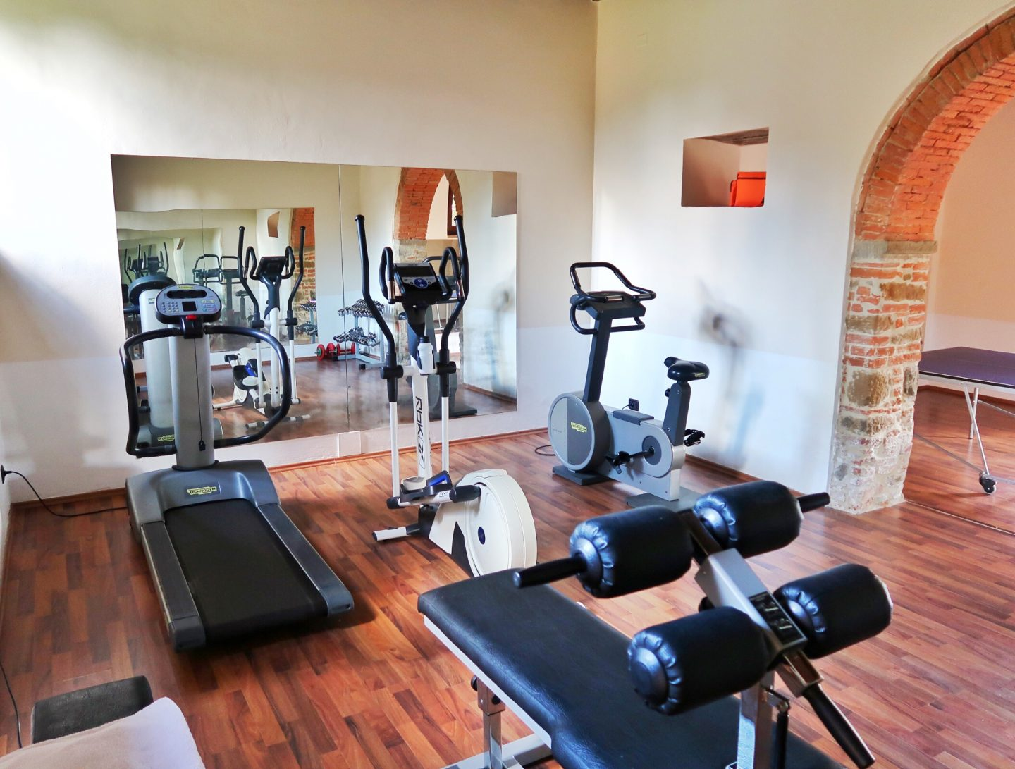 The amazing gym at the villa we stayed at courtesy of Bookings for you, modern and spacious with plenty of equipment and a large mirror at the end.