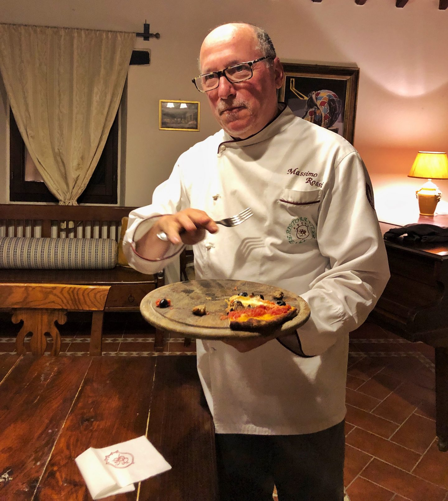On a recent press trip courtesy of Bookings for You, we had pizzas cook for us by lovely Chef Massimo, featured in this photos, holding a wooden board and wearing smart chef whites with his name on.