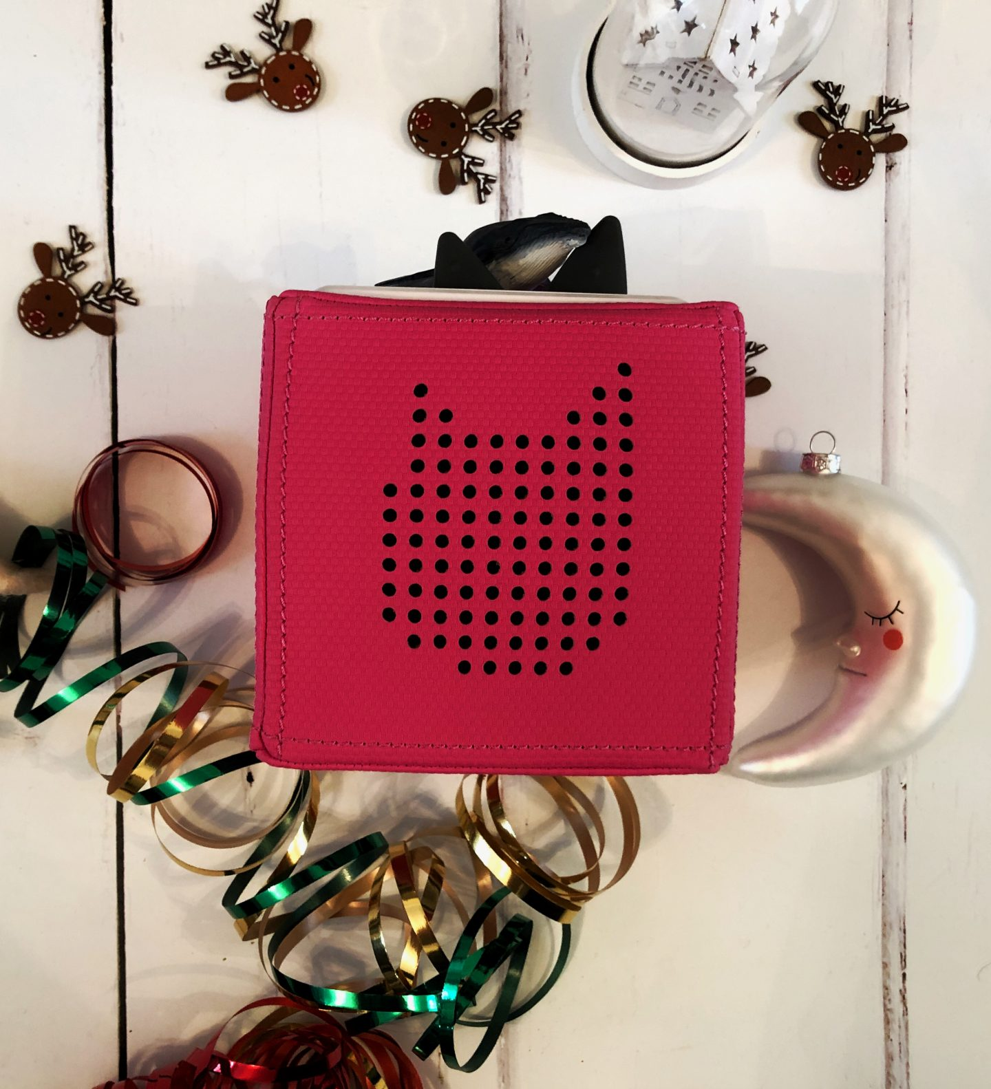 Image of a pink Tonie box story speaker cube for my guide for Christmas camping gifts for campervan kids guide.