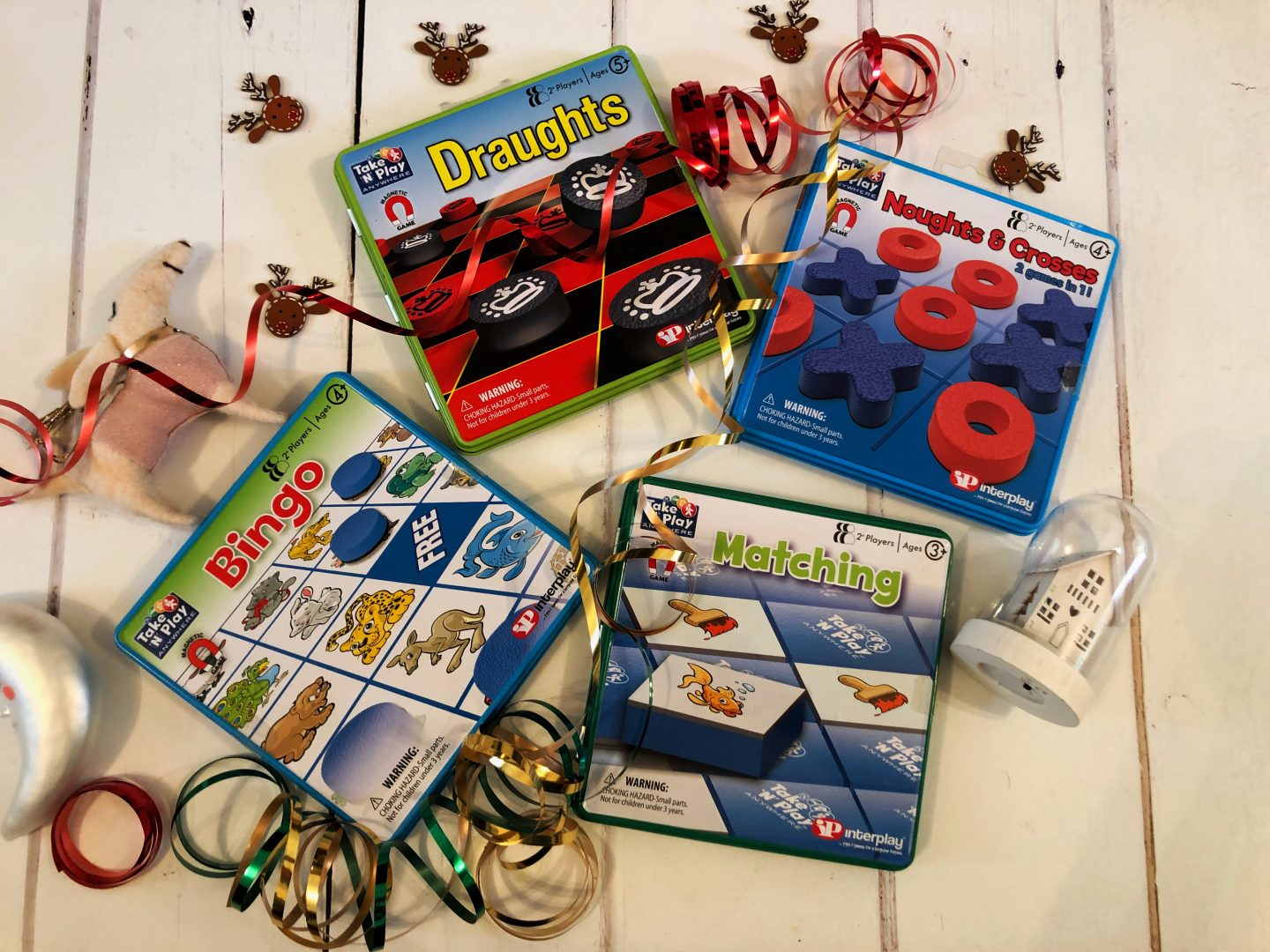 Image of a selection of magnetic game tins for my guide for Christmas camping gifts for campervan kids guide.