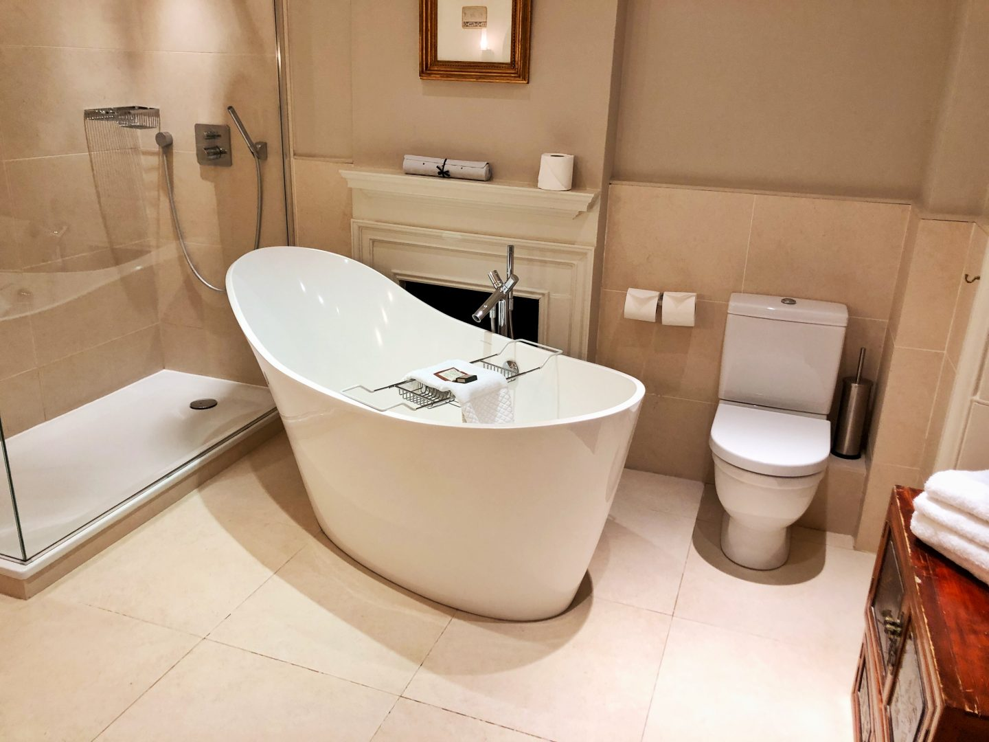The stunning roll top bath in the hotel, the room is cream and there is also an enormous shower.