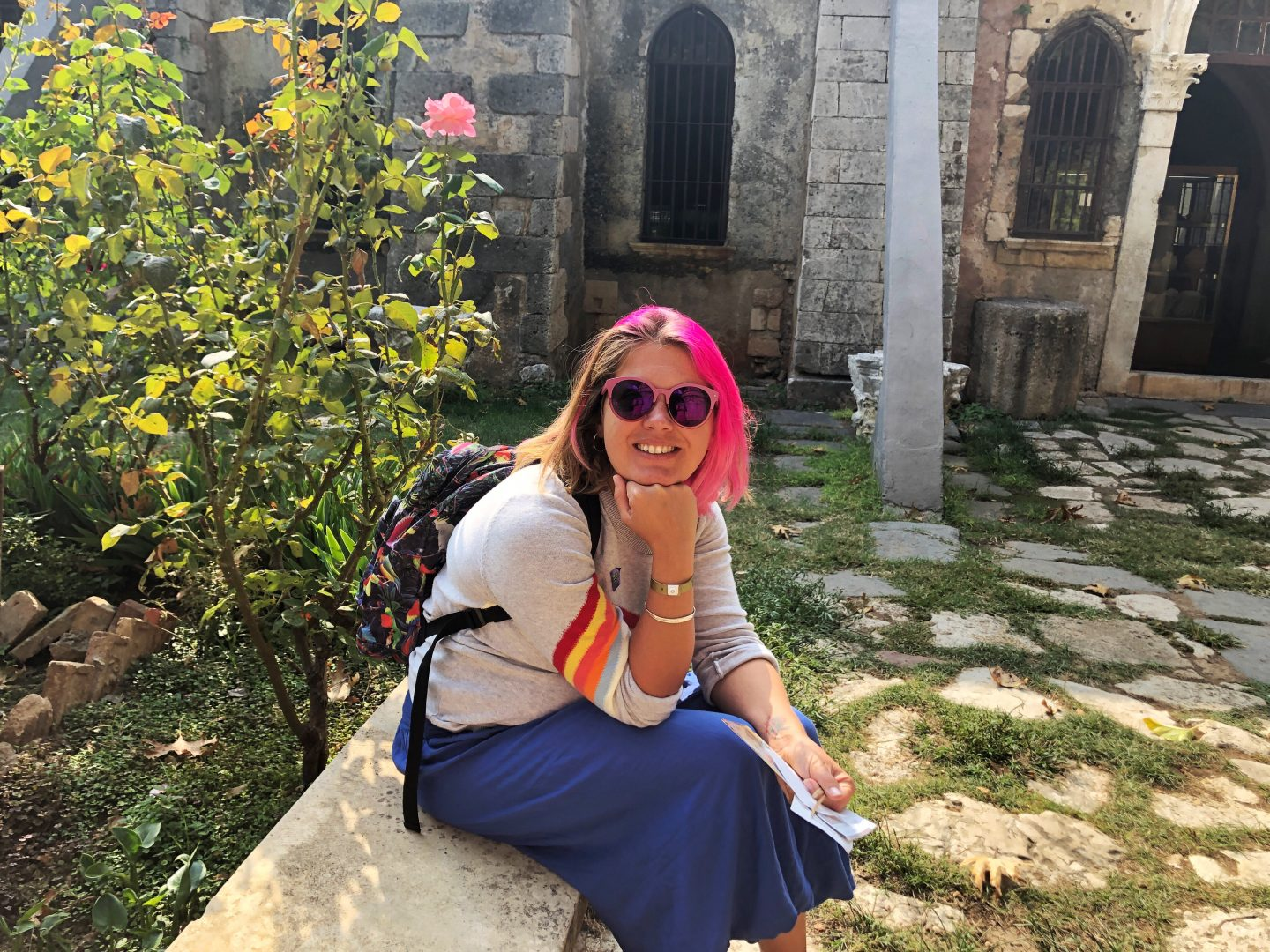 A photo of me, looking at the camera and smiling at the Chania museum.