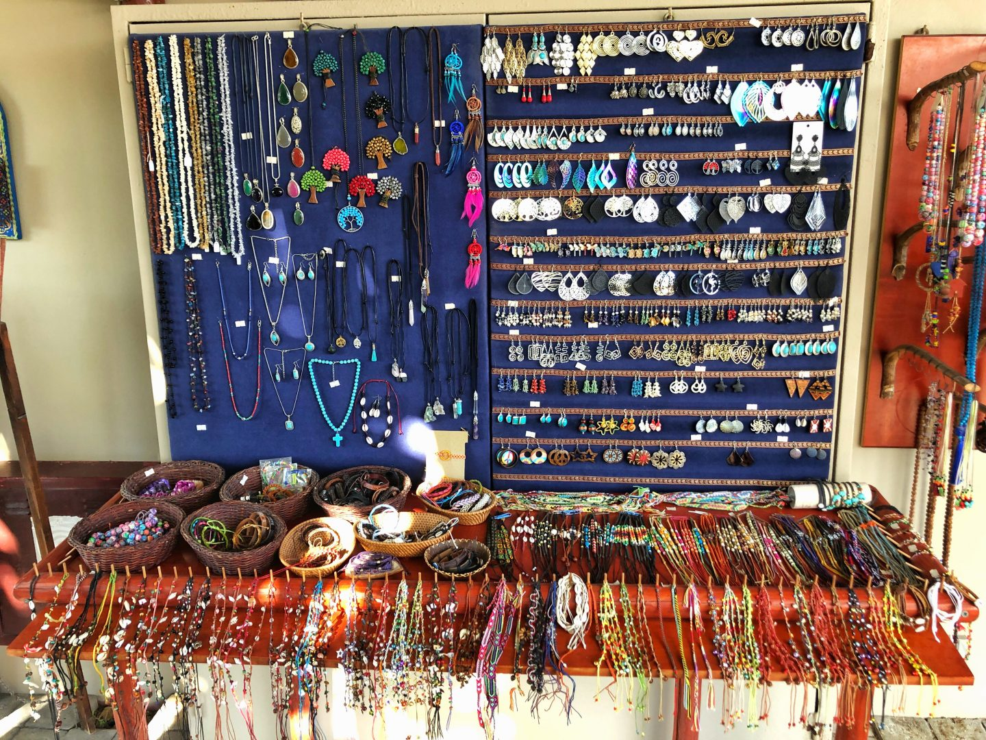 A beautiful jewellery display with hundreds of colourful bracelets and earrings.