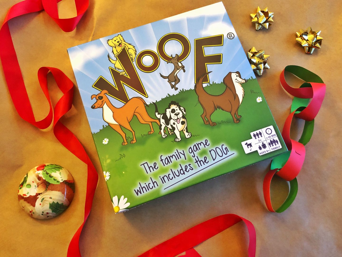 Festive flatlay of the family game which includes the dog, Woof!