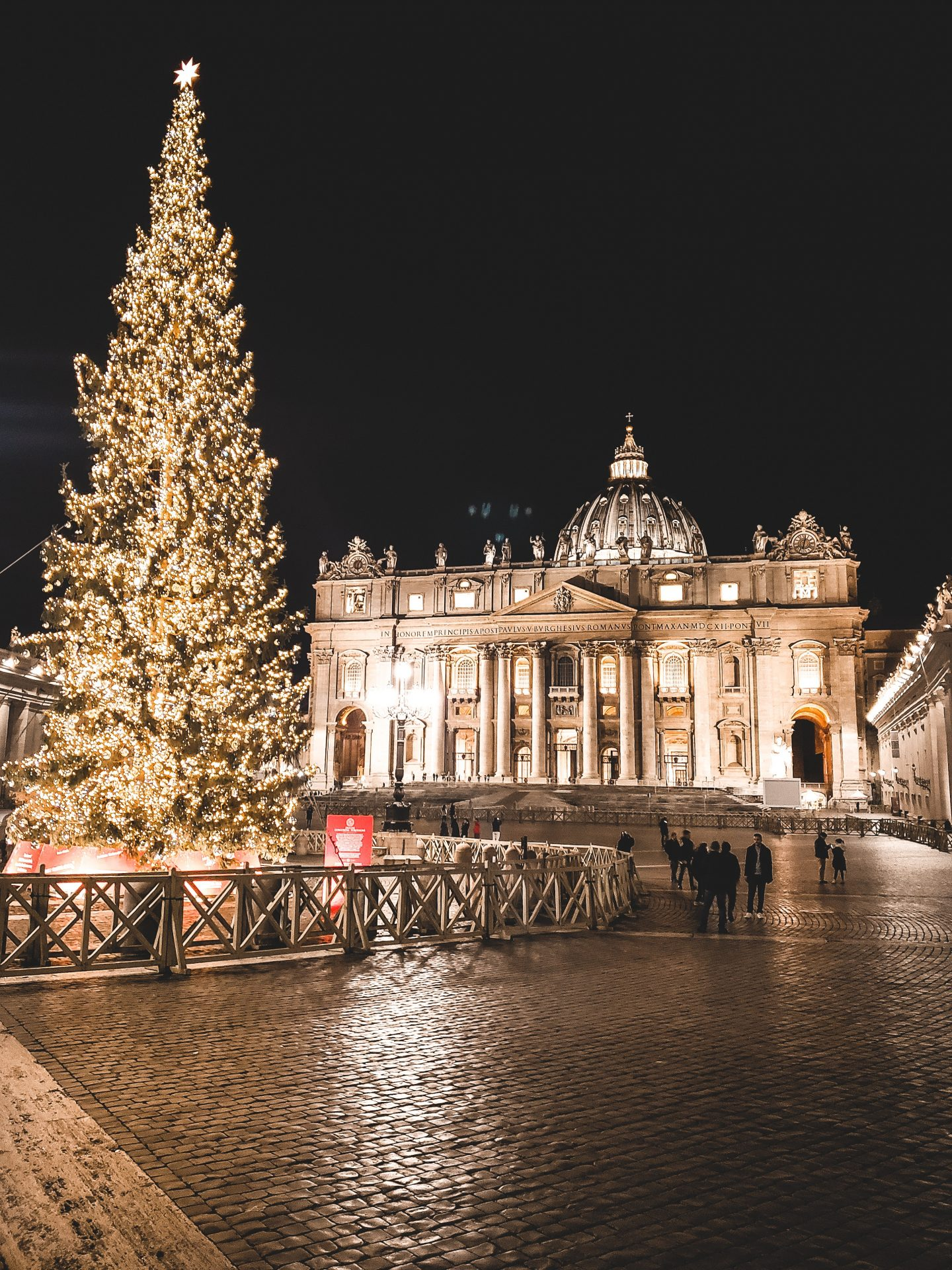 Stock image of an enormous lit up tree in a square in St Peter's Square Vatican City.
